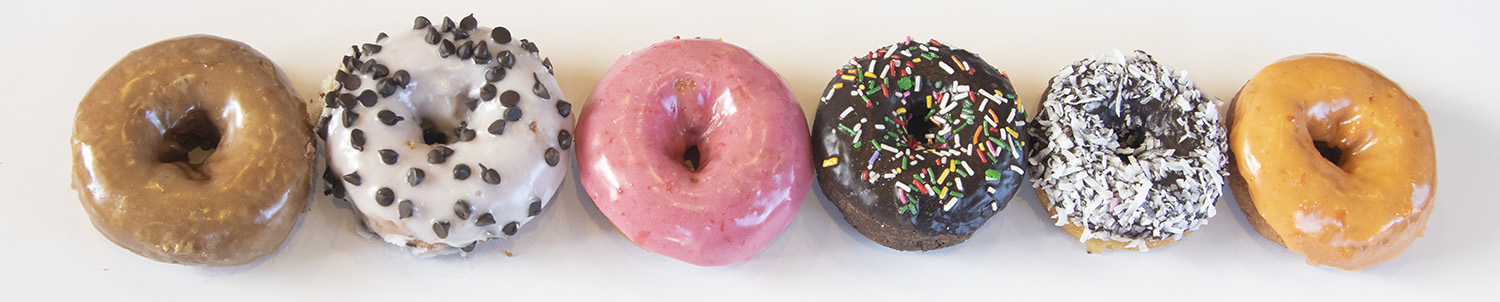 row of cake donuts