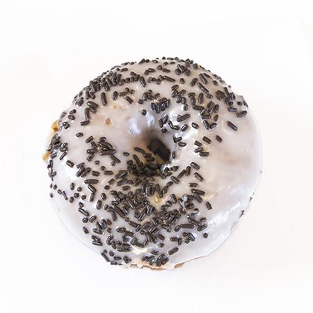white cake vanilla frosting chocolate sprinkles donut